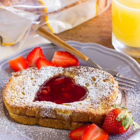 Share Gluten-Free Nutella Stuffed French Toast with a cherry-jam heart with your sweetheart for Valentine's Day.