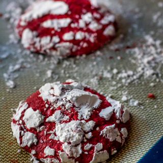 Gluten Free Red Velvet Crinkle Cookies are soft and cakey, with hints of real cocoa and vanilla. Covered in sweet powdered sugar, they make a fun and festive cookie.