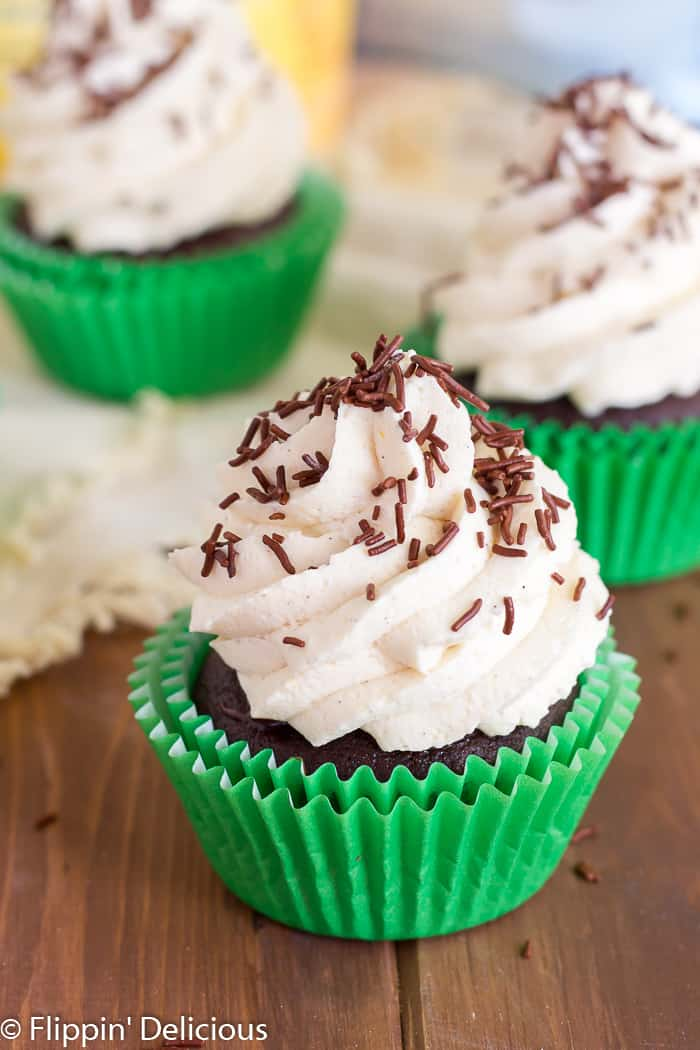 Gluten Free Irish Cream Cupcakes are filled with Irish cream chocolate ganache, and topped with fluffy Irish cream whipped cream frosting.