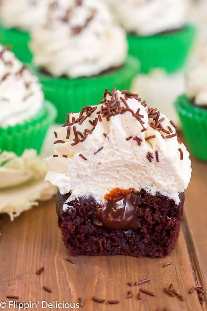 Gluten-Free Irish Cream Cupcakes are filled with Irish cream ganache, and topped with fluffy Irish cream whipped cream. The ultimate cupcake for any Irish cream lovin' leprechauns in your life!