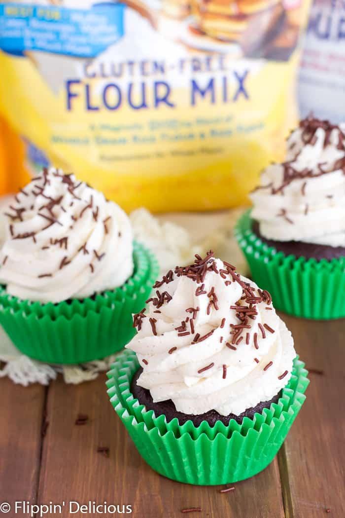 Gluten Free Irish Cream Cupcakes are filled with Irish cream chocolate ganache, and topped with fluffy Irish cream whipped cream frosting.