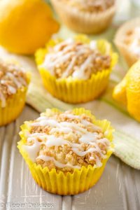 Gluten Free Lemon Crumb Muffins are sweet & bright gluten free lemon muffins with streusel. Great flavor from lemon juice, lemon zest, & lemon extract! Dairy free option.