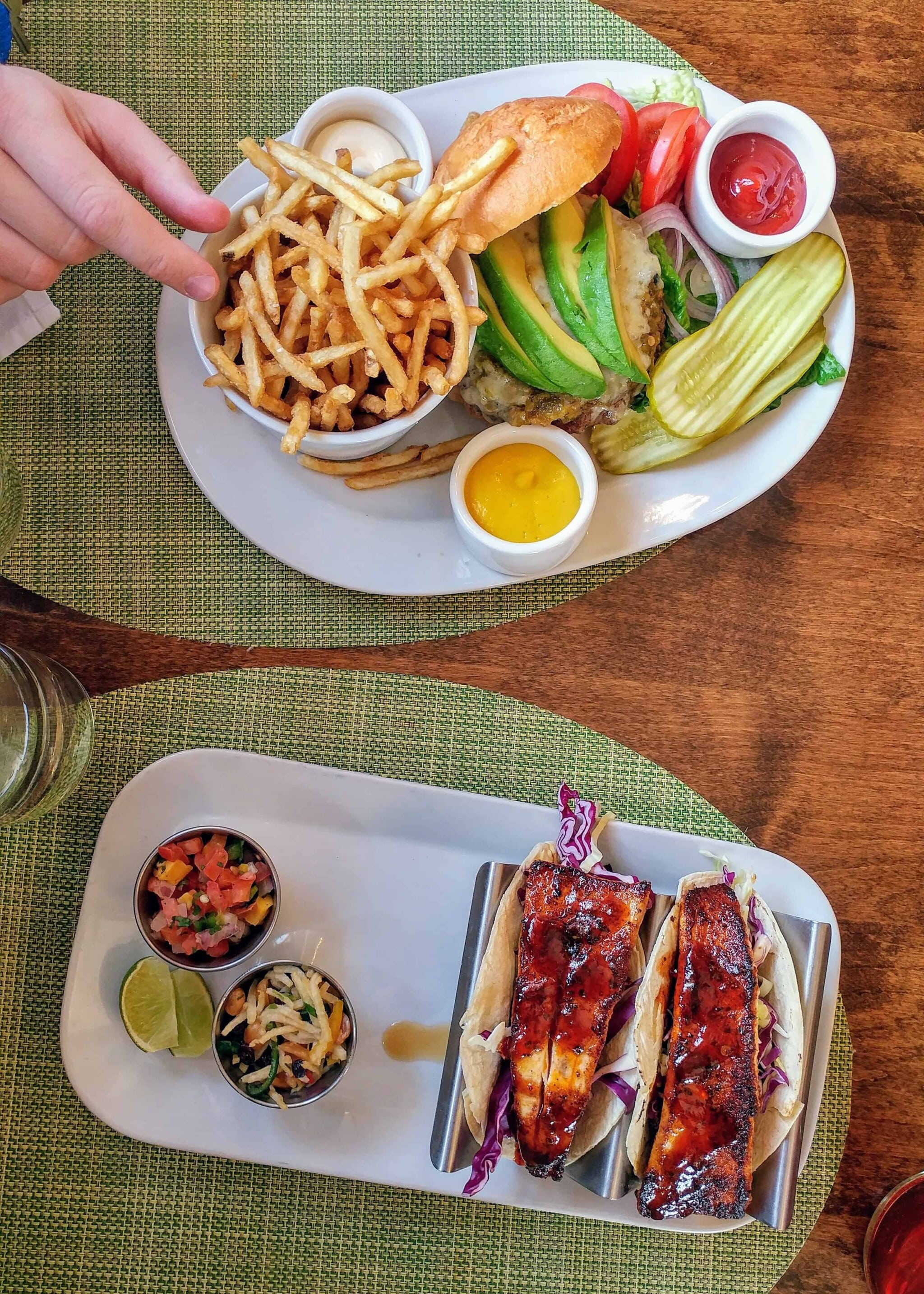 fish taco and burger with avocado on top and fries at ojo caliente new mexico
