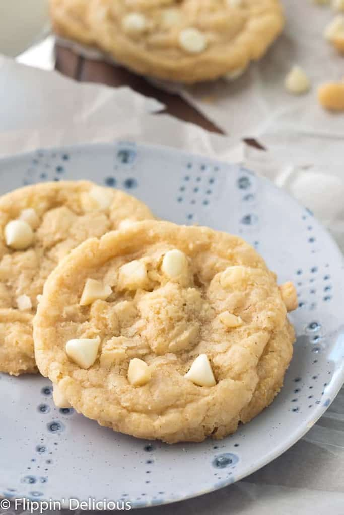 Gluten Free White Chocolate Macadamia Nut Cookies- Classic buttery white chocolate chip cookies with macadamia nuts. No chill gluten free cookie dough with a Dairy-free option. #glutenfree #glutenfreecookies #whiteChocolate #dairyfreecookies #dairyfree #macadamianut