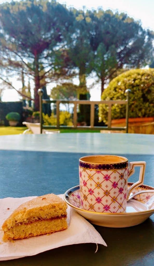 drinking espresso and a gluten free scone at villa boccella, overlooking gardens