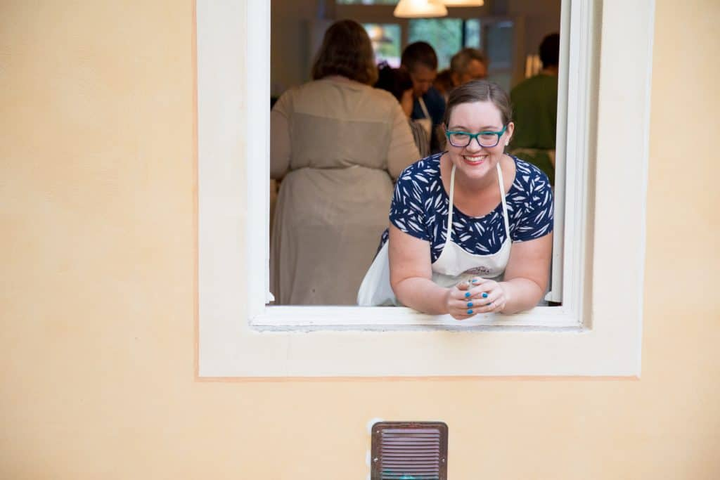 woman leaning out window at villa boccella at jovial gluten free getaway in lucca italy