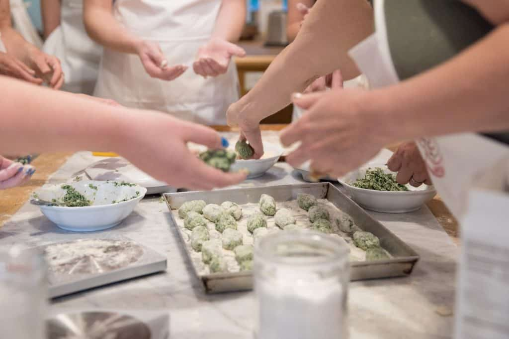 hands making gluten free gnudi at jovial gluten free getaway in lucca