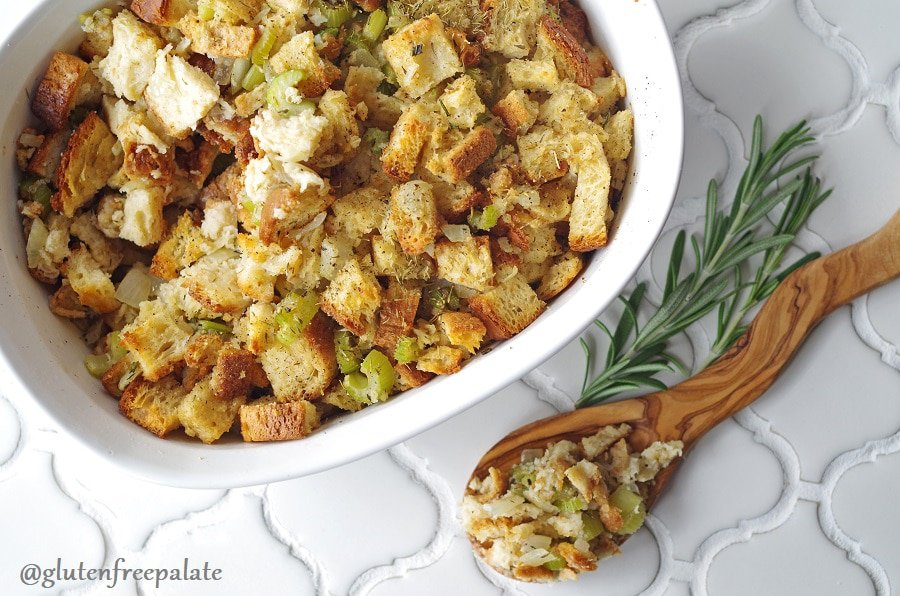 gluten free stuffing with celery and onions in a white casserole dish