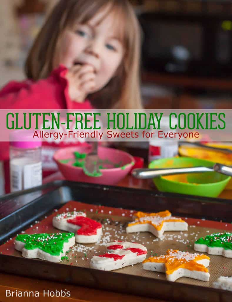 "girl eating gluten free sugar cookies with text overlay ""Gluten Free Holiday Cookies"""