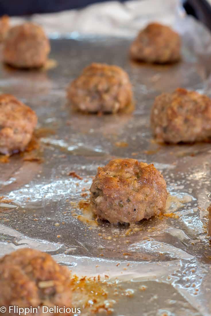 gluten free turkey meatballs sitting on aluminum foil