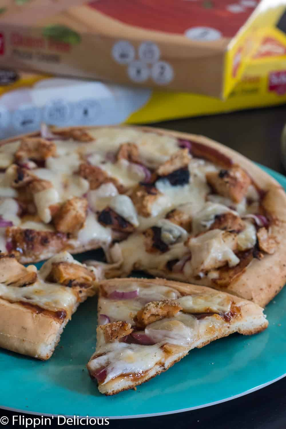gluten free grilled barbecue chicken pizza on a blue plate