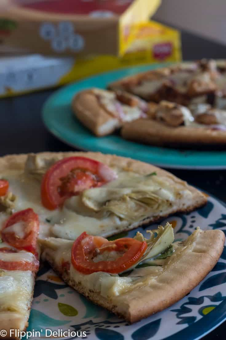 Start by brushing the edge of your pizza crust with olive oil, then lightly spread your sauce of choice, and then add your toppings evenly. #glutenfree #glutenfreerecipes #grilledpizza