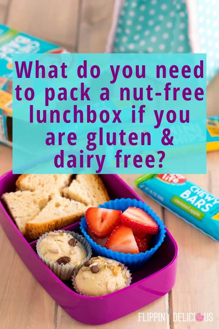 "photo of nut free lunch ideas with a lunch container packed with muffins, strawberries and a sandwich on a wooden table with a snack bar in the background with text overlay ""what do you need to pack a nut-free lunchbox if you are gluten & dairy free?"