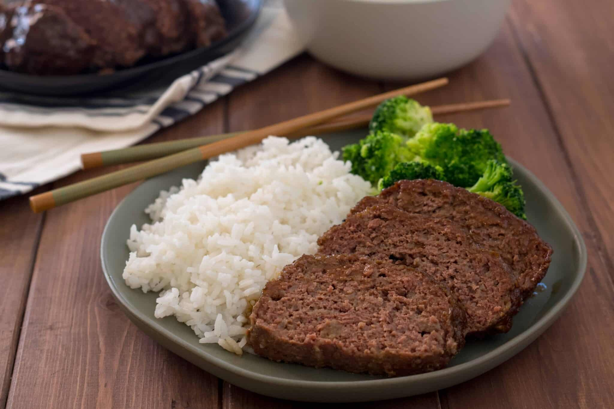 gluten free teriyaki meatloaf cooked in an instant pot sliced on a green plate