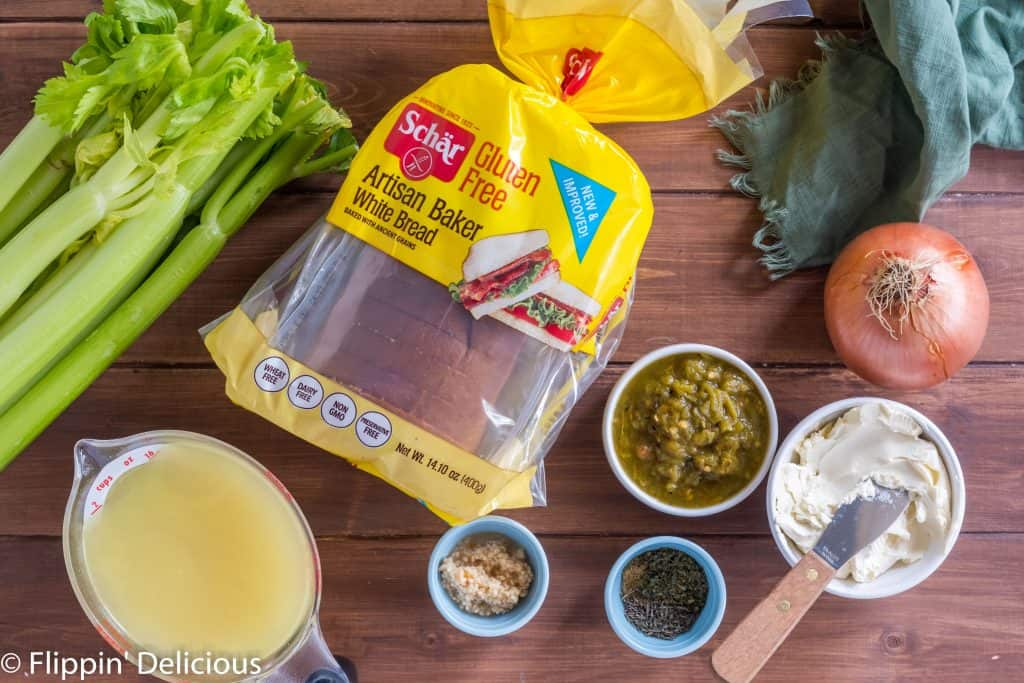 ingredients to make gluten free stuffing with hatch green chile, celery, green chile, herbs, broth, spices, butter, onion, and schar gluten free artisan baker white bread