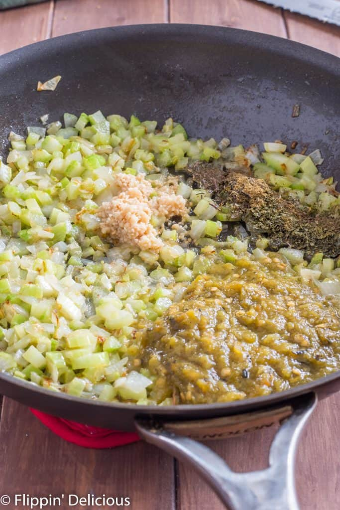 sauteed celery and onions in a skillet, with minced garlic, herbs, and green chile just added