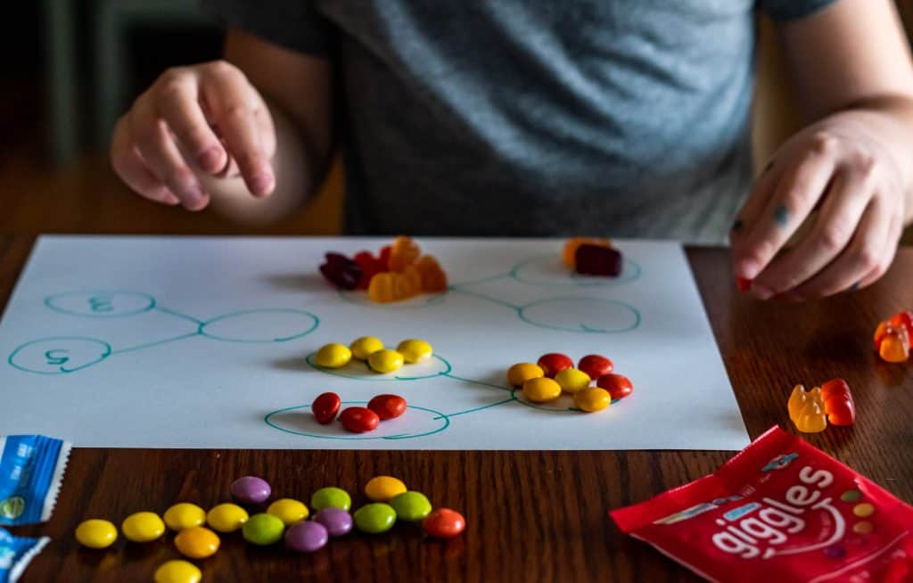 small child using candy to complete number bonds